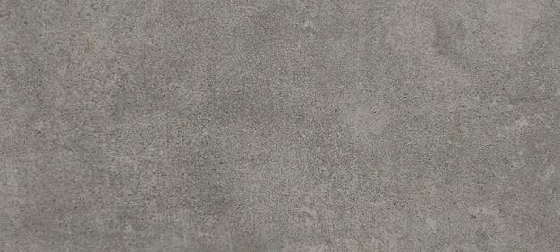 Prostokątne szare tło w postaci ciętego kamienia, granitu lub marmuru. na podłogę lub ścianę