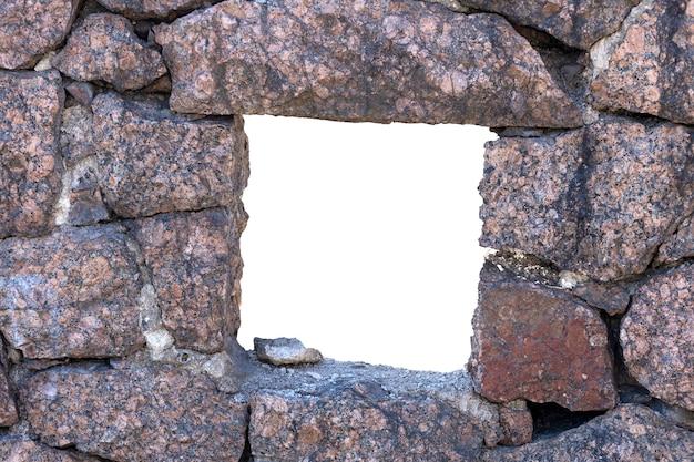 Prostokątny otwór w ścianie wykonany z kamienia naturalnego. zdjęcie wysokiej jakości