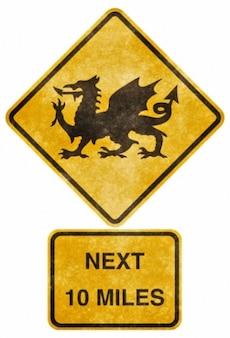 Przekraczania drogowego grunge znak walijskie smoka