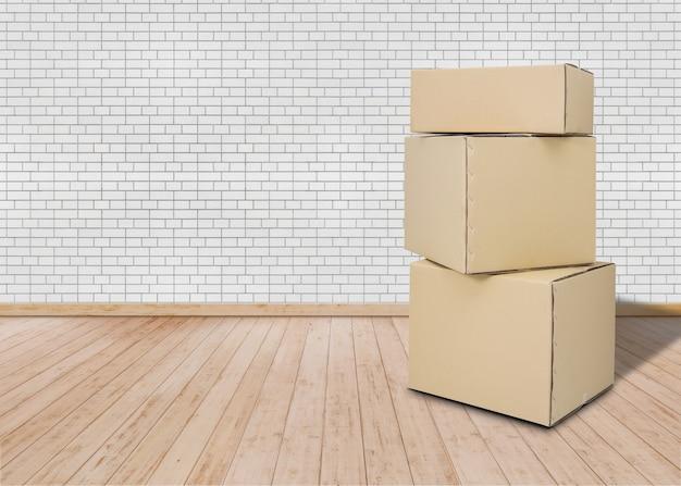 Przeprowadzka w nowym domu. pusty pokój z pudełkami kartonowymi