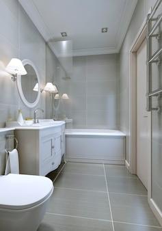 Przestronna nowoczesna łazienka z klasycznymi meblami, okrągłym lustrem