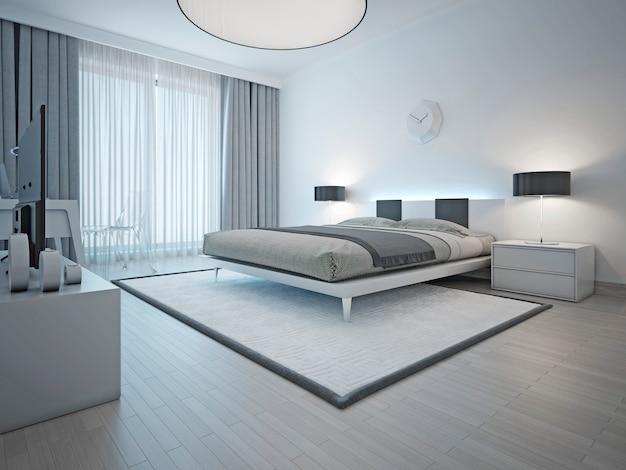 Przestronna sypialnia w nowoczesnym stylu z białym dywanem oraz jasnoszarymi ścianami i meblami.
