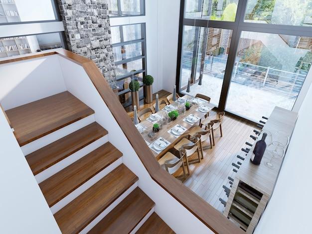Przestronny pokój z dwupiętrowymi panoramicznymi oknami, kominkiem z kamiennym kominem i winiarnią.