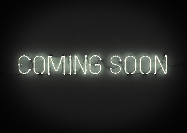 Przychodzić wkrótce neonowego znaka na ciemnym tła 3d renderingu