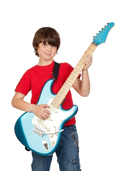 Przystojna chłopiec whit gitara elektryczna nad białym tłem