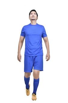 Przystojny azjatykci atleta mężczyzna z błękitną dżersejową pozycją