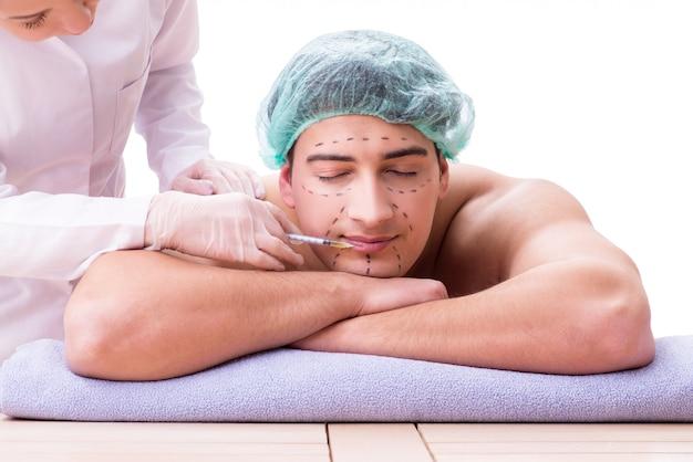 Przystojny mężczyzna w spa masaż koncepcji
