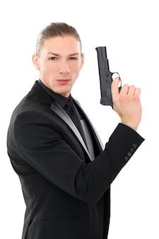 Przystojny mężczyzna z pistoletem
