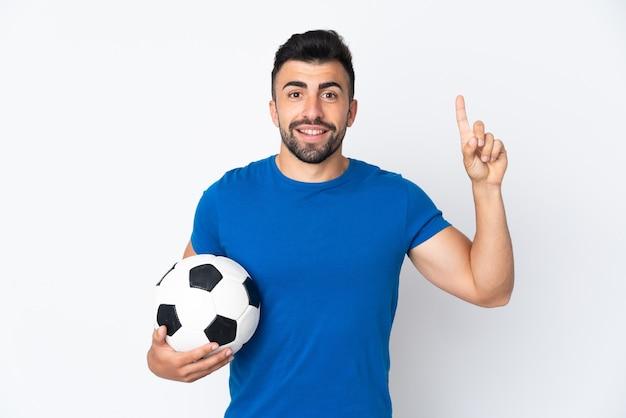 Przystojny młody mężczyzna piłkarz na pojedyncze ściany skierowana w górę świetny pomysł