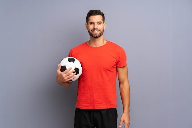 Przystojny młody piłkarz człowieka
