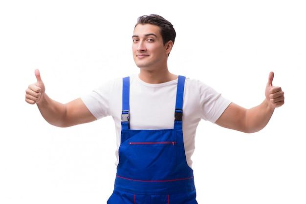 Przystojny repairman jest ubranym coveralls odizolowywających na bielu