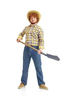 Przystojny rolnik, farmer na białym tle