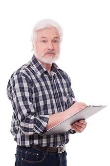 Przystojny starszy mężczyzna pisze