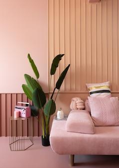 Przytulny narożnik salonu z różową sofą pokrytą wygodnymi różowymi poduszkami na zdobionej ścianie