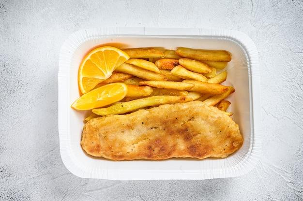 Pudełko na wynos danie z rybą i frytkami z frytkami