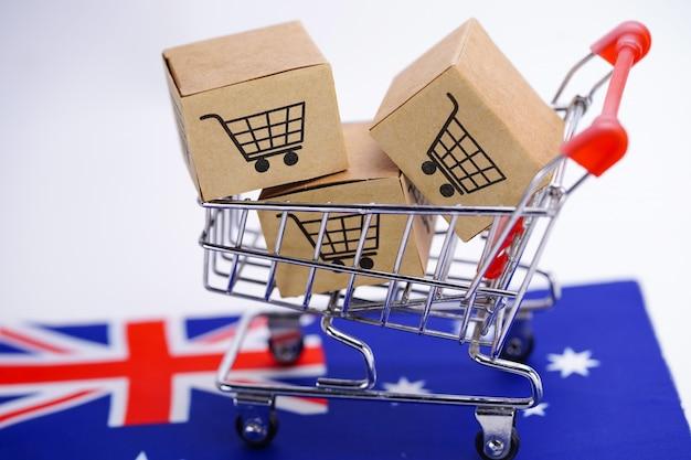 Pudełko z logo koszyka na zakupy i flagą australii: import export shopping online lub ecommerce dostawa usług sklepowych wysyłka produktów, handel, koncepcja dostawcy.