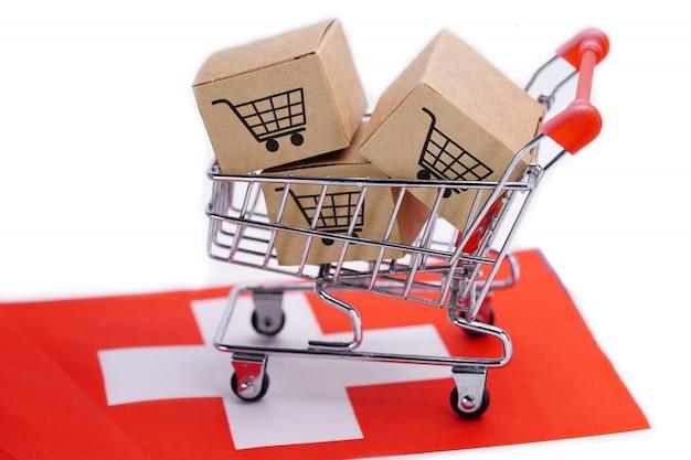 Pudełko z logo koszyka na zakupy i flagą szwajcarii