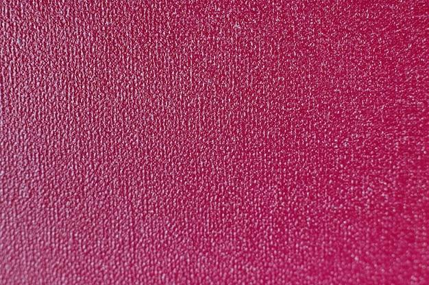 Purpurowe teksturowane tło. głęboki magenta teksturowane ciemne tło.