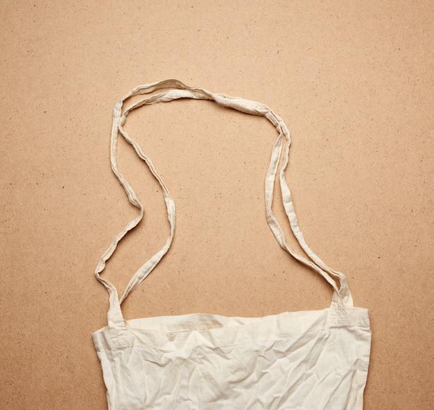 Pusta bawełniana torba na zakupy wielokrotnego użytku z bawełny na brązowym,