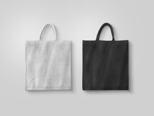 Pusta biała i czarna bawełniana torba ekologiczna na białym tle