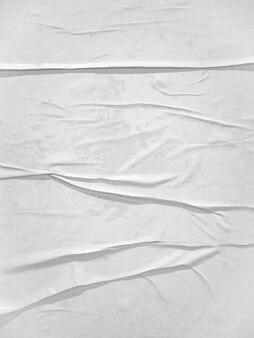 Pusta biała tekstura papieru przyklejona na ścianie
