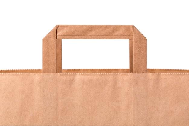 Pusta brązowa papierowa torba na białym tle
