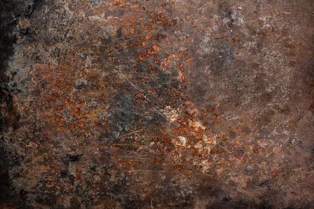 Pusta brązowa zardzewiała powierzchnia lub zardzewiała metalowa tekstura.