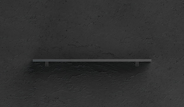 Pusta czarna półka na książki montowana na teksturowanej ścianie