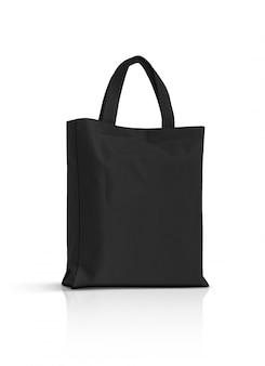Pusta czarna tkanina brezentowa torba odizolowywająca na bielu