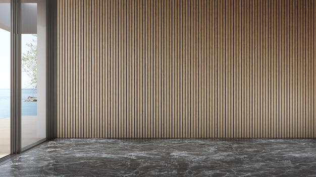 Pusta drewniana ściana na pustej czarnej marmurowej podłodze dużego salonu