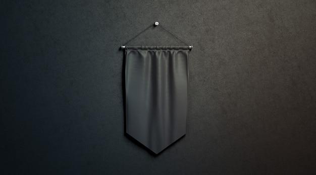 Pusta makieta proporzec czarny romb, powiesić na czarnej ścianie w ciemności