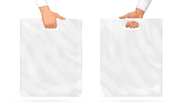 Pusta plastikowa torba, trzymając w ręku