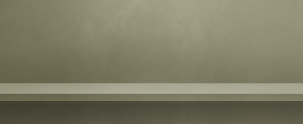 Pusta półka na przyciemnionej szarej ścianie. scena szablonu tła. baner poziomy