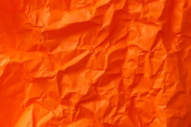 Pusta pomarańczowa pomarszczona tekstura zmięty papier. kreatywna tapeta
