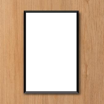 Pusta rama plakat na koncepcji projektu brązowym tle drewna