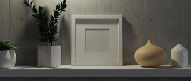 Pusta ramka makiety do twojego obrazu na białej półce rośliny w nowoczesnych doniczkach ceramicznych wazonach szara ściana
