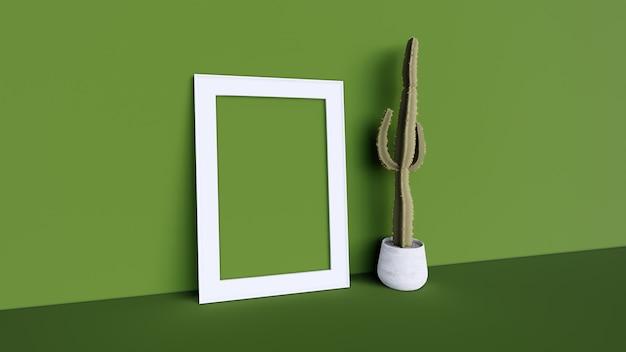 Pusta ramka na zdjęcia i kaktusowe drzewo z zieloną ścianą