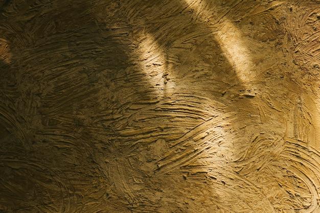 Pusta teksturowana żółta stiuk tapeta
