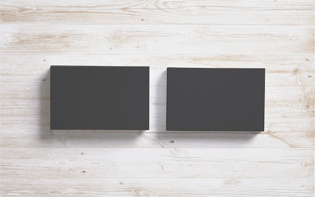Puste czarne wizytówki na tle drewniane biurko