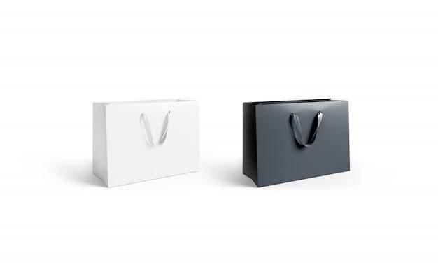 Puste czarno-białe papierowe torby z jedwabnymi uchwytami