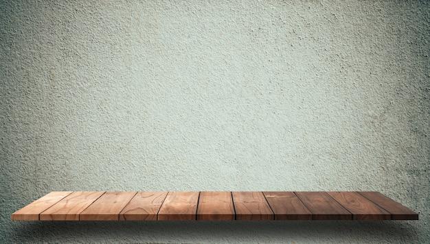 Puste górne drewniane półki z cementowe ściany tło