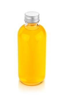 Puste opakowanie soku pomarańczowego w szklanej butelce na napój