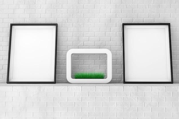 Puste ramki do zdjęć z trawy w białej ceramiki doniczka na ceglany mur skrajny zbliżenie.