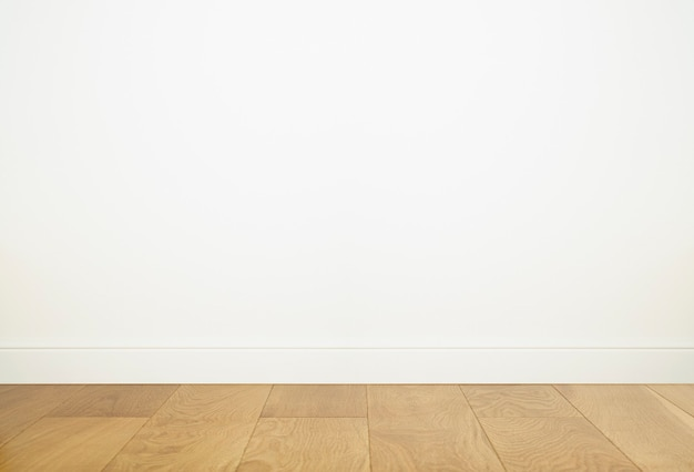 Puste wnętrze pokoju z białym tłem ściany i pustą drewnianą podłogą