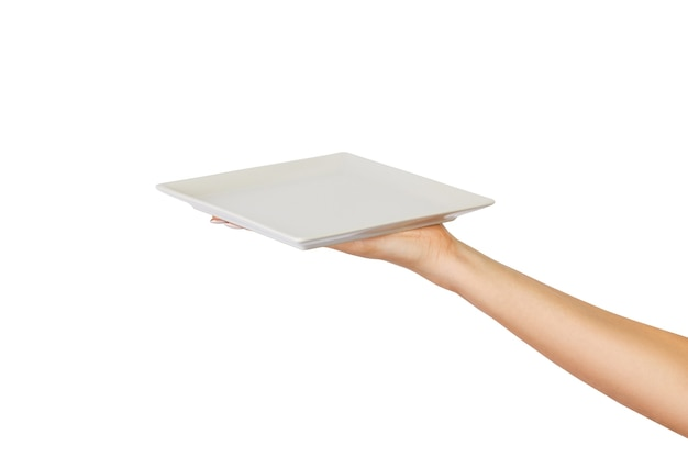 Pusty biały kwadratowy talerz matowy w kobiecej dłoni