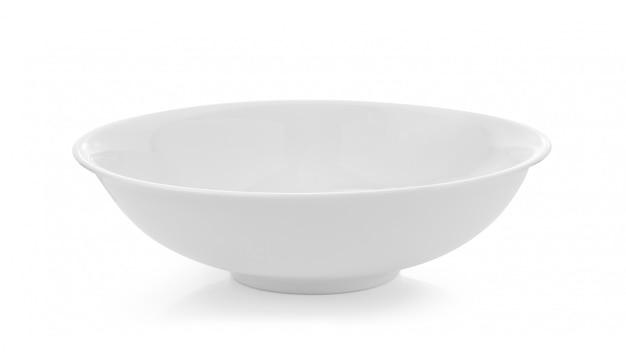 Pusty biały puchar odizolowywający na biel przestrzeni