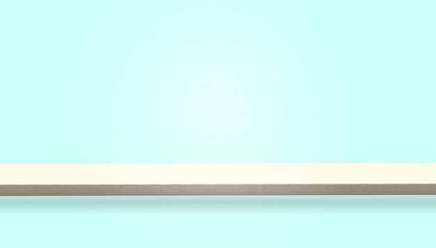 Pusty blat stołu z drewna lub kontuar na białym tle na niebieskim tle, może służyć do wyświetlania lub montażu produktów