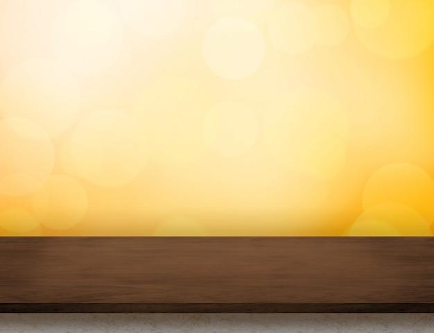 Pusty ciemnobrązowy drewniany stołowy wierzchołek przy pomarańczowym bokeh światła tłem