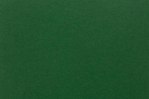 Pusty kawałek zielonego papieru jako tło. zbliżenie. wysokiej jakości tekstura w ekstremalnie wysokiej rozdzielczości