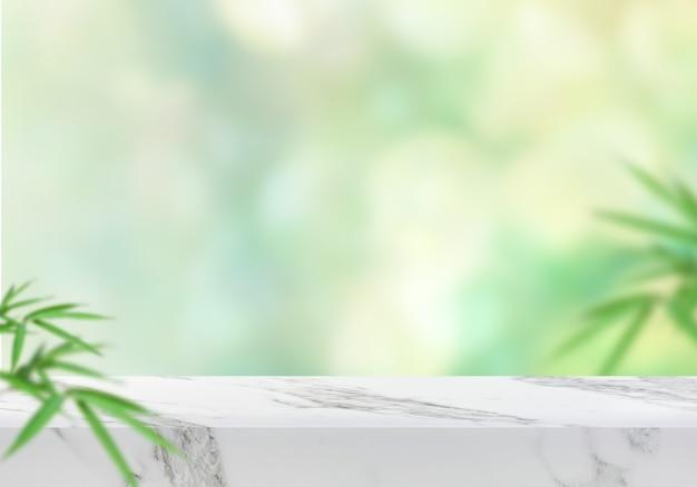 Pusty marmurowy stół z liśćmi i zielonym tło produktu bokeh